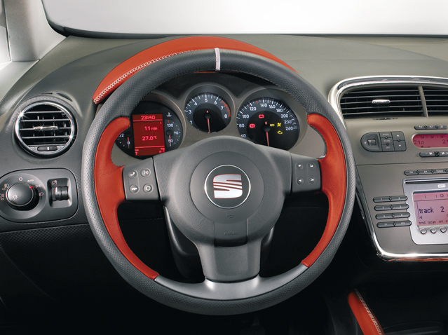 Red leather steering wheel with remote control
